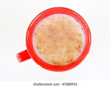 The cup full of hot drink with cream and nutmeg on light background