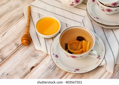 Cup of Ginger tea with lemon and honey on white background, top view