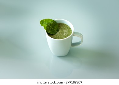 A cup of a green smoothie, healthy drink and food that fits for a diet