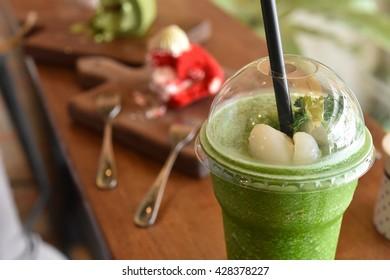 Cup of green tea frappe , Green tea smoothies with fresh Rambutan