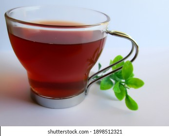 Cup of green tea with leaves on white background