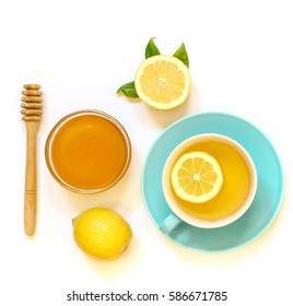 Cup of green tea with lemon and honey isolated on white background. View from above.