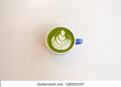 A cup of green tea matcha latte for background