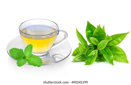 Cup of green tea with mint and green leaf isolated on a white
