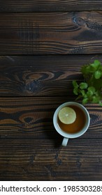 a cup of healthy drink - lemon tea on wooden background with copy space