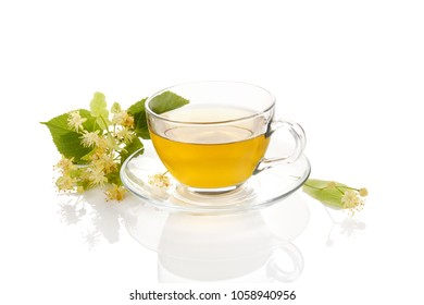 Cup of healthy herbal linden tea with linden flowers . Isolated on white background.