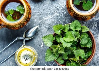 Cup of healthy herbal tea with nettle.Tea with fresh nettles.Herbal tea