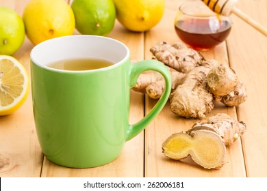 Cup of healthy tea with honey ginger and lemon on wooden background, concept for healthy nutrition