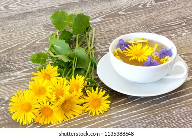 cup of herb tea with coltsfoot