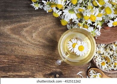 cup of herbal chamomile tea with camomile dry blossoms, dried camomile flowers. doctor treatment and prevention of immune concept,  medicine - folk, alternative, complementary, traditional medicine