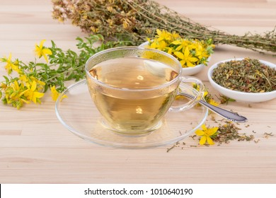Cup of herbal tea with dried and fresh St. John's wort