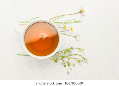 cup of herbal tea on white table