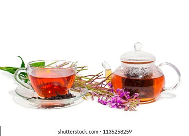 Cup of herbal tea and teapot with blooming Chamerion angustifolium (common names: fireweed, great willowherb, rosebay willowherb) isolated on white background