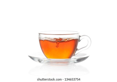 Cup of hot black tea with air bubbles isolated on white