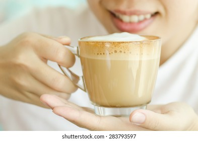 The cup of hot cappuccino coffee ready to drink