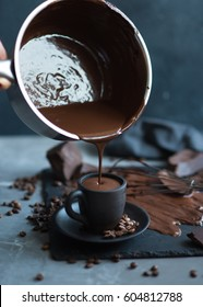 Cup of hot chocolate against grey stone background