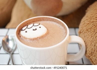 A cup of hot chocolate with Cute Marshmallow, Abstract blur of Giant Teddy bear on the background. Take a break concept. Soft focus on Marshmallow