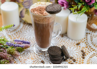 Cup of hot chocolate decorated on table in cafeteria