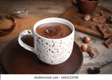 Cup of hot chocolate on wooden table - Shutterstock ID 1665115558