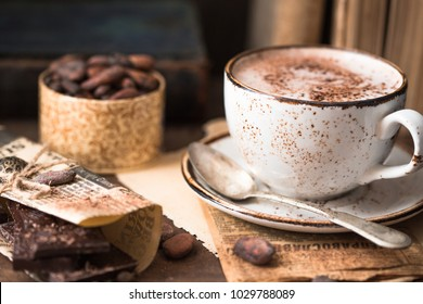 Cup of hot cocoa or hot chocolate on wooden background . Traditional beverage for winter time, vintage toning.