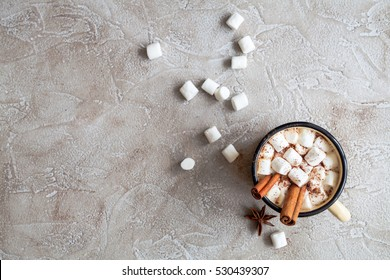 Cup of hot cocoa with marshmallow, top view
