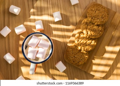 Cup of hot cocoa with marshmallows on the wooden table
