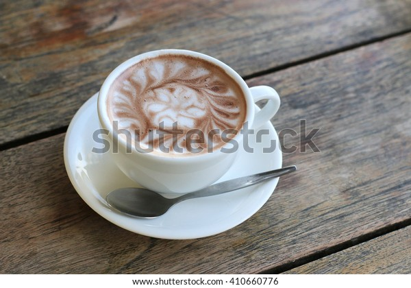 cup of hot cocoa on wood table