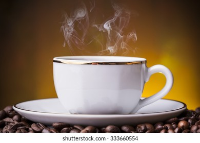 Cup with hot coffe on grunge background