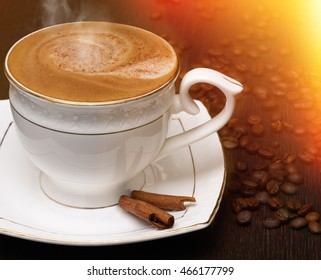 Cup of hot coffee cappuccino with cinnamon