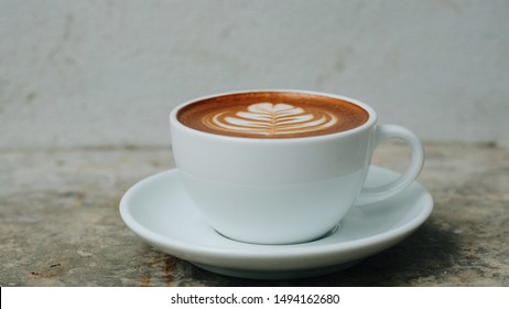 a cup of hot coffee latte art