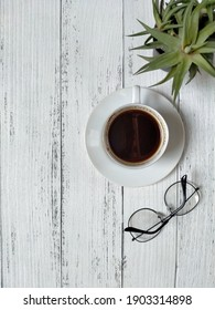 Cup of hot coffee on white background. Early morning breakfast