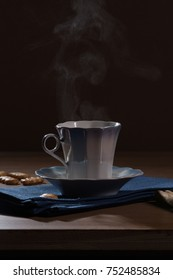 cup of hot coffee, from which steam rises