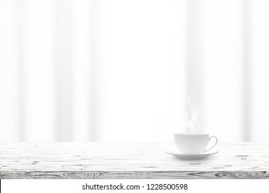 Cup with hot drink on wooden table and window curtains on a background