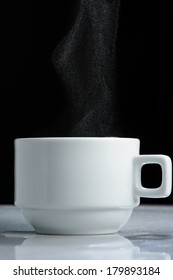 Cup of hot drink with steam