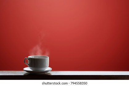 Cup of Hot drinks with stream, on red background