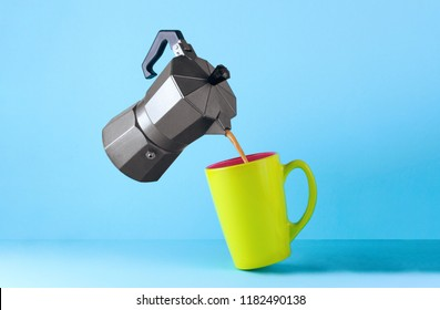 A cup of hot, fresh coffee, a coffee maker and roasted toast bread popping up of toaster on a blue background. Wake up early in the morning for a delicious breakfast. Good morning.