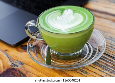 a cup of hot milk green tea on a table