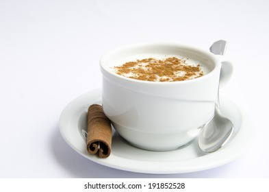 Cup of hot milk with shaved cinnamon
