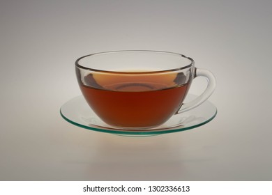 Cup of hot red tea isolated on white background