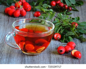 A cup of hot tea with a dog rose and hawthorn. Hawthorn and dog rose.