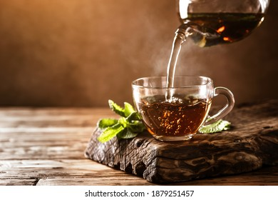 Cup of hot tea with fresh mint leaves