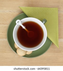 A cup of hot tea on a table - shot from above
