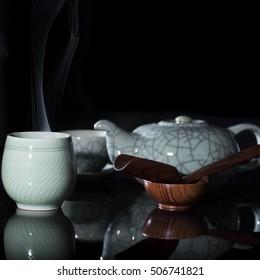 Cup of hot tea with steam on dark background. Supplies preparazoine