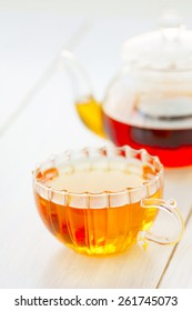 cup of hot tea tea, sugar and lemon on a light background