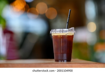 Cup of ice blackcoffee with light bokeh background