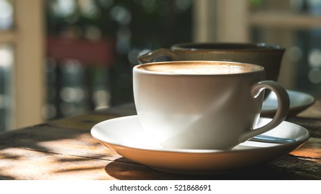 Cup image of hot Latte coffee with Americano coffee on vintage wooden table in cafe