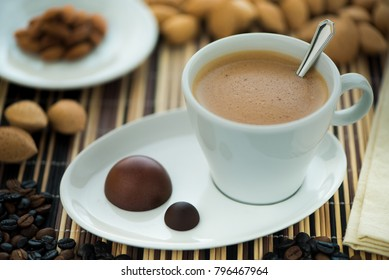 cup of instant coffee wit almonds chocolates
