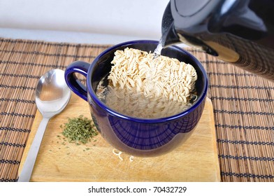 cup of instant noodles soup with spoon