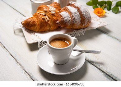 Cup of italian espresso and brioches
