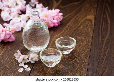 A cup of Japanese sake pouring
